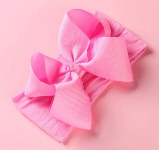 Стильная повязка на голову для девочки с бантом, розового цвета